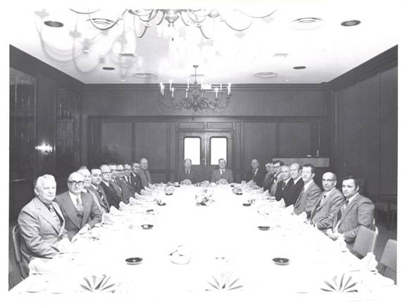 Photo taken in 1975 of the Co-operative's board of directors sitting around a large table in a meeting room