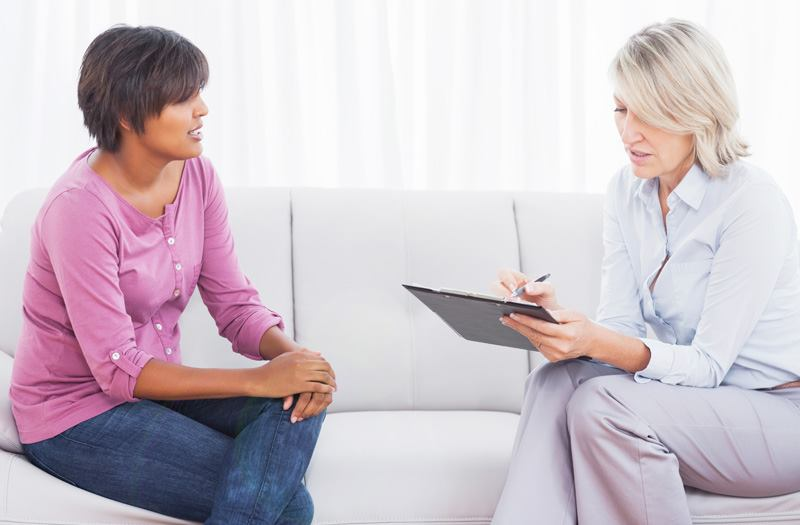 A therapist listens to a patient