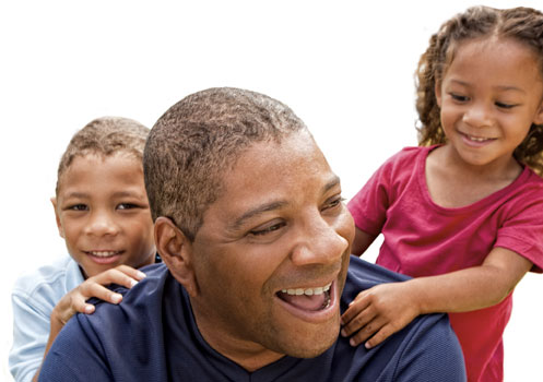 Father and two kids smilling